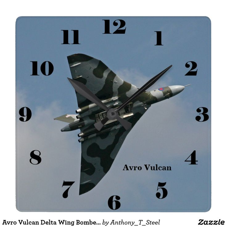 Avro Vulcan Delta Wing Bomber all numbers Square Wall Clock The Avro Vulcan Delta Wing Strategic Bomber against a blue sky, with the bomb bay open on the front of a square clock which makes a great gift for an aviation enthusiast. The clock has numbers.