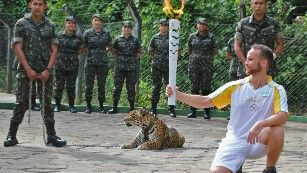 The jaguar that was later killed is seen during Monday's Olympic torch relay.This is TOTAL Animal ABUSE! Who ever thinks to take a wild animal.We will look so cool.F%$#& idiots.A beautiful animal is dead now.Show respect.That cat should not have been there in the first place