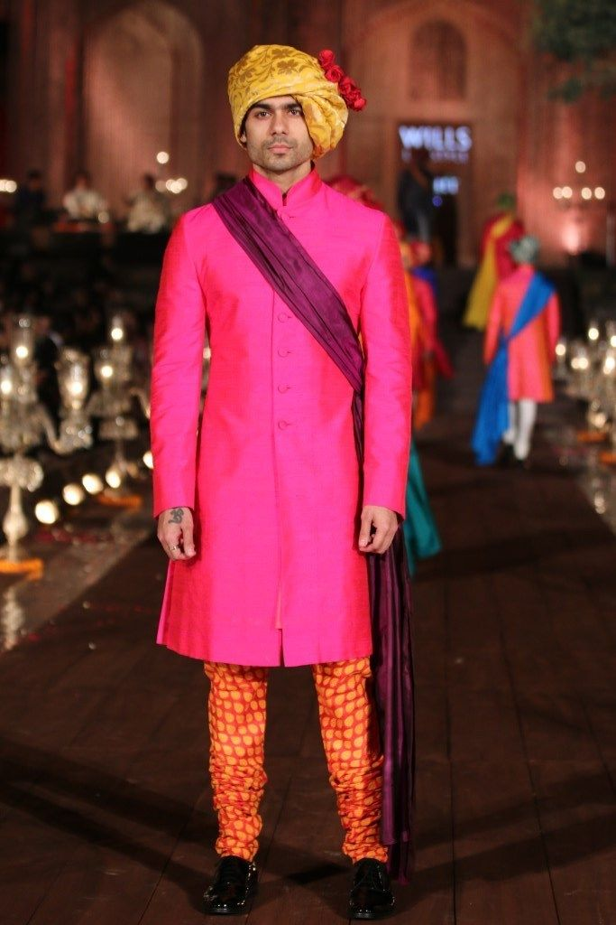 Men in hot pink sherwani jacket | JJ Valaya Garden of Flowers Fashion Runway Collection