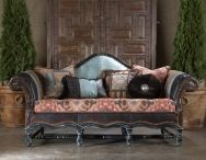 """Hacienda Sofa $6897  The Hacienda Sofa is the most dramatic Southwestern sofa we have seen created!  The beautiful turquoise leather and rich western fabrics bring together the sofa for Santa Fe you have long wanted!  Dark Brown leather laces the arms as well as the front of this sofa.  These five pillows are coordinated to add that Dude Ranch appeal!  A very special sofa and there is a wonderful coordinating chair as well.  47""""H x 94""""W x 38""""D"""
