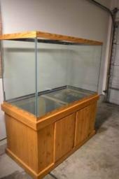 GORGEOUS 150 GAL FISH TANK AQUARIUM PINE STAND + ACCESSORIES!!!!! in Hainesville IL 60030 for $600.00. Beautiful 150 Gallon Fish Tank Aquarium with Pine Stand perfect for your home or office! This tank is in excellent condition. Houseguests are envious of it, children are in awe of it and it will lower your stress level just having it in your presence.  I also have the Glass Lids for the Top, Light Fixture/Hood, Heater, Pumps, Hoses, Filters, Tons of Gravel, Trees and other decor with the…