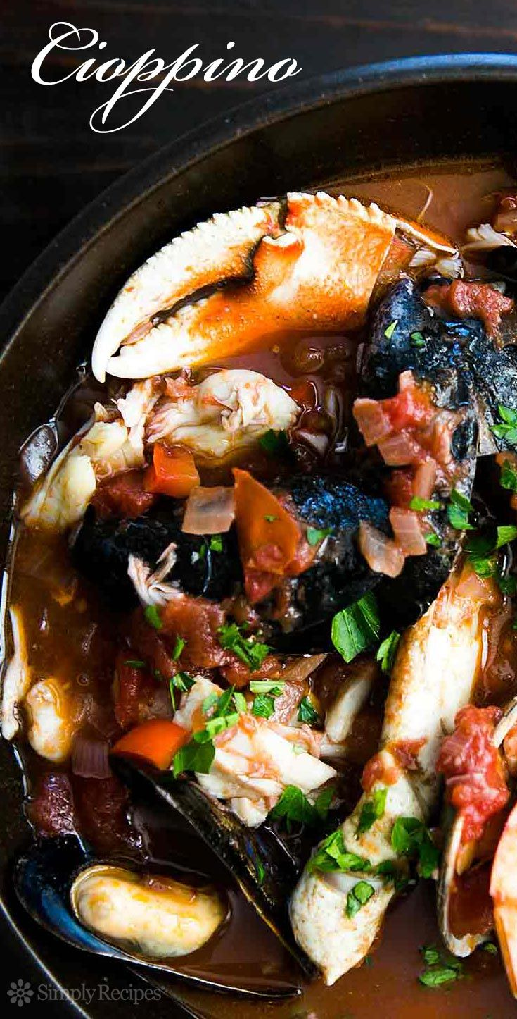 Best seafood stew EVER! San Francisco-style cioppino with halibut, sea bass, Dungeness crab, shrimp, mussels, and oysters. On SimplyRecipes.com