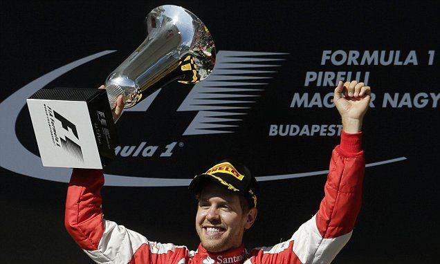 Sebastian Vettel lands Hungarian Grand Prix #DailyMail