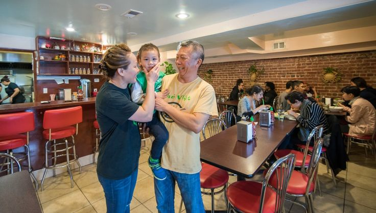 Pho Viet Owners Phi Nguyen, left, and Minh Chau with son Ton, 3, met while attending University of the District of Columbia
