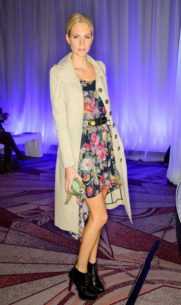 Poppy Delevingne paired a floral-print dress with a military-style trench and ankle boots at Anya Hindmarch.