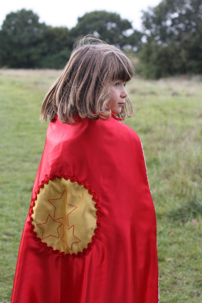 This is a lovely red satin with the same 100% cotton fabric lining as the ice cape. Satin circle motif has hand embroidered star design and is encircled with a large red ricrac. This cape is 76 cms in length (A likes the Darth Vadar effect of the floor length cape on him). Again length can be adapted dependent on child size. Price from £25 All cape designs can be personalised either with a specific theme or initial.