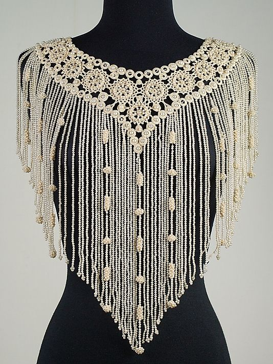 Collar made of silk, linen and beads. Part of the Brooklyn Museum Costume Collection at the Metropolitan Museum of Art.