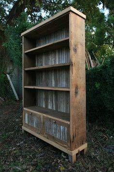 Cool idea: old tin on the back of a bookcase.
