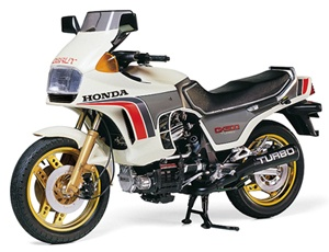 The Tamiya Honda CX500 Turbo in 1/6 scale from the plastic motorcycle model range accurately recreates the real life Japanese sports motorcycle. This plastic motorcycle kit requires paint and glue to complete.