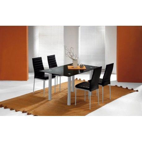 Conjunto de mesa con cuatro sillas para salón comedor o cocina. Es un conjunto de mesa metálica con tapa de cristal blanco o negro de 8mm de grosor con estructura metálica blanco y gris plata  con cuatro sillas metálicas tapizadas.