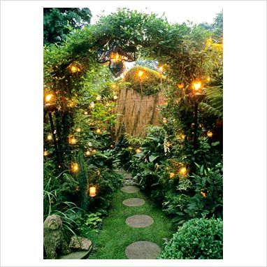 A secret garden. I love the golden lights. And is that a bamboo fence I see? Love it.