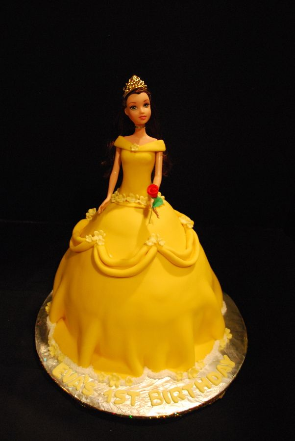 I LOVED THIS CAKE! I almost didn't want to take it to the client. I enjoyed this cakes beauty to the extreme. I have always been a beauty and the beast lover, so when I finally got to make a princess belle cake, (yeah i know, im a little kid at heart), what can I say I was jumpin for joy! This was the classic marble cake with buttercream icing. The draping, was fun and challenging. The idea came from another photo, and I loved the inspiration! Thanks for looking. CSM