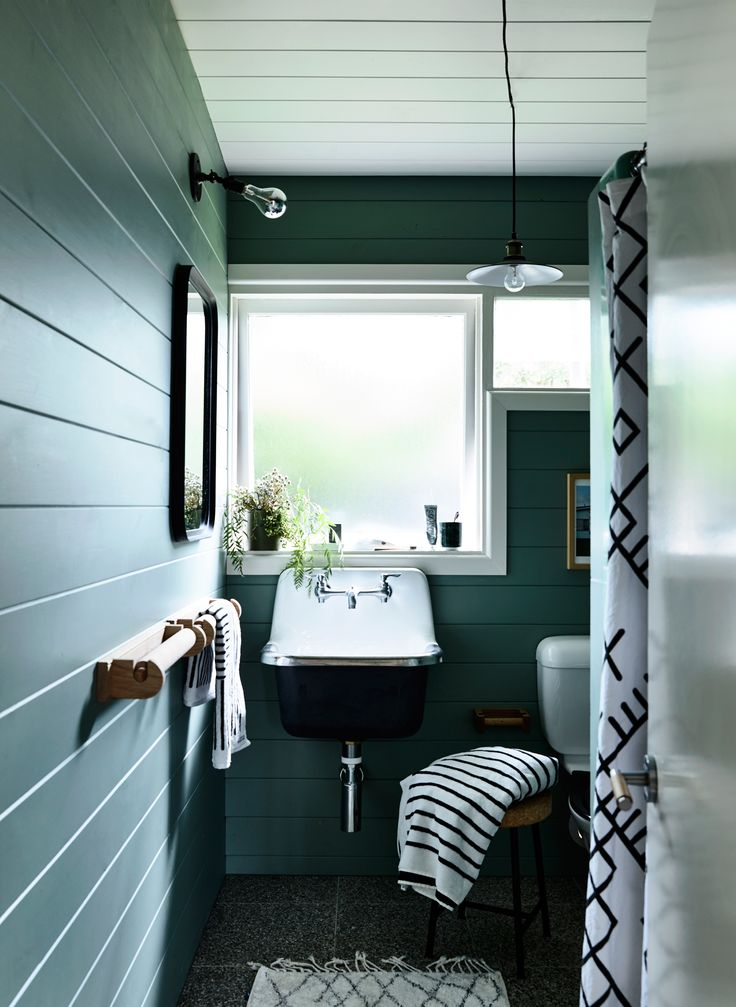 Green bathroom from beach shack makeover by stylist Simone Haag. Story: Derek Swalwell | Styling: Simone Haag | Story: real living