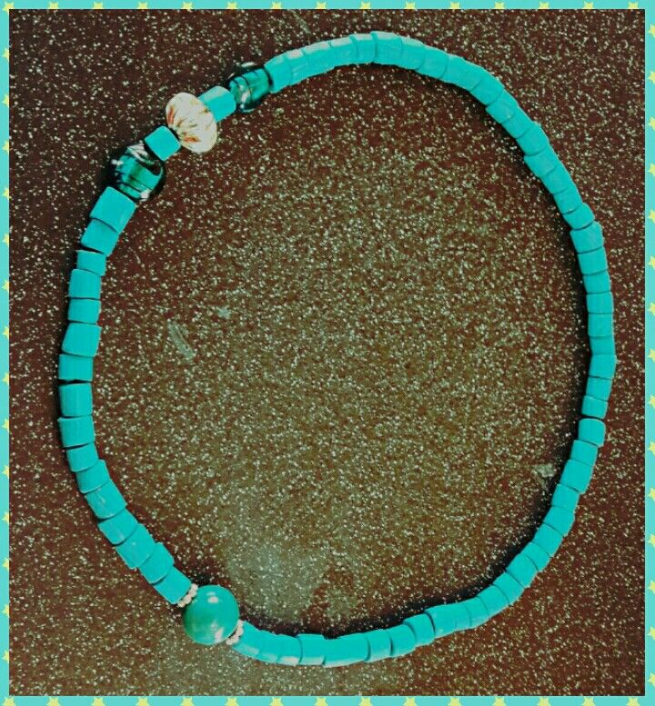 Handmade Fimo beaded necklace in teal with added recycled plastic and glass beads. #handmadecrafts #fimocraft #fimobeads #tealnecklace