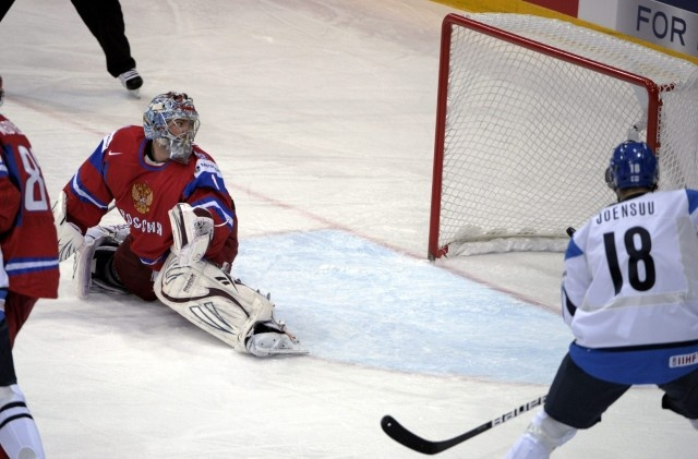 Russia's goalkeeper Semyon Varlamov looks behind as the puck passes him into the net during the semi-final match Russia vs Finland of the 2012 IIHF Ice Hockey World Championships in Helsinki, Finland, on May 19, 2012, at right Finland's Jesse Joensuu.