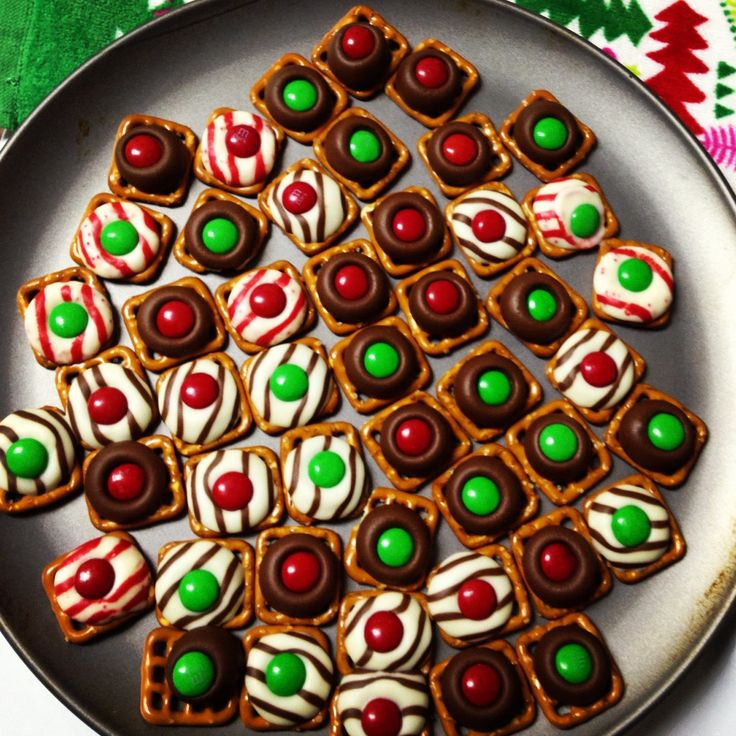 Yummy! Square pretzel, rolo or Hershey's kiss of your liking and top off with m&m.   Bake pretzel with chocolate at 325 for 5-10 minutes. Just enough to make the chocolate soft enough to push down on, not melting everywhere.