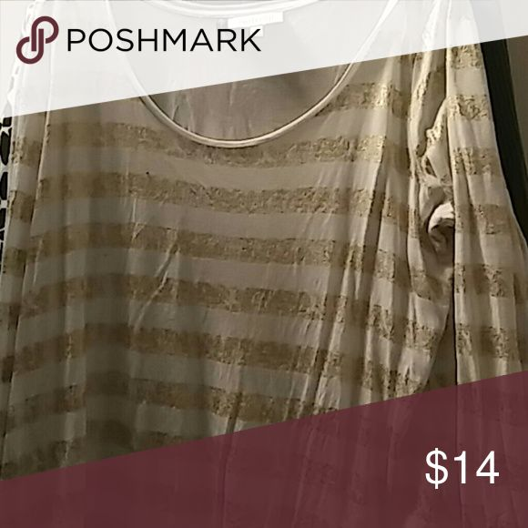 Jennifer Lopez tee Gold metallic tee not glittery style but just right. Top longer in back but not cropped in front/. It comes to you waist Jennifer Lopez Tops Tees - Long Sleeve