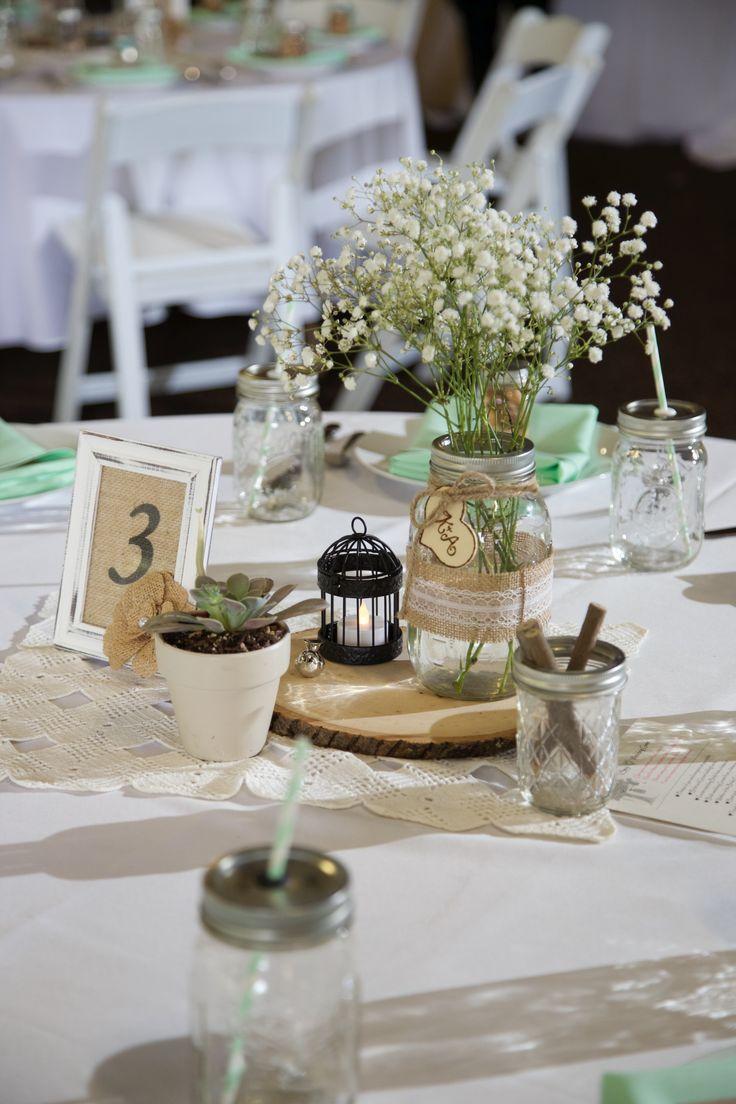 Rustic centerpieces wood slabs mason jar vases burlap
