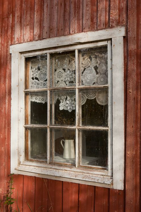 Love the pieced together doily window treatment!