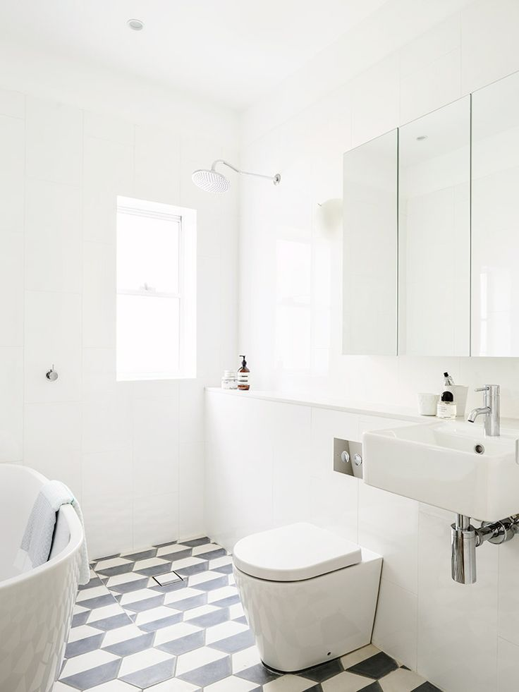 Tiled floors in white bathroom