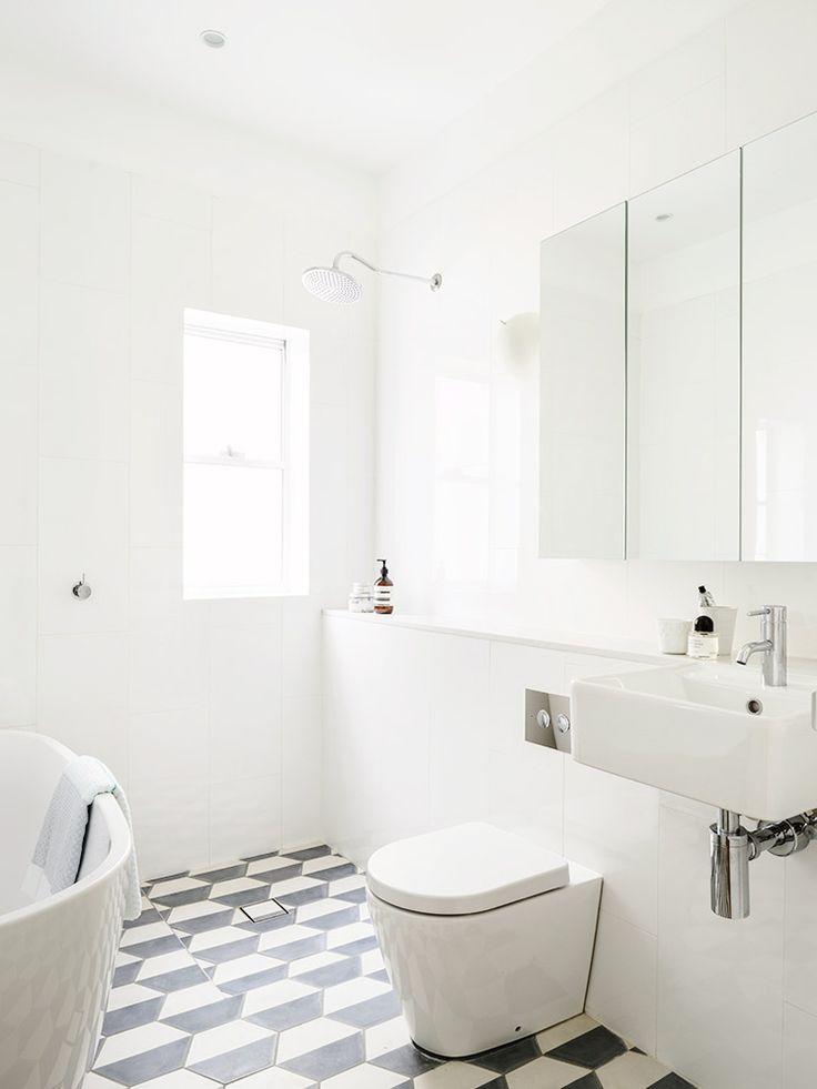 Tiled floors in white bathroom
