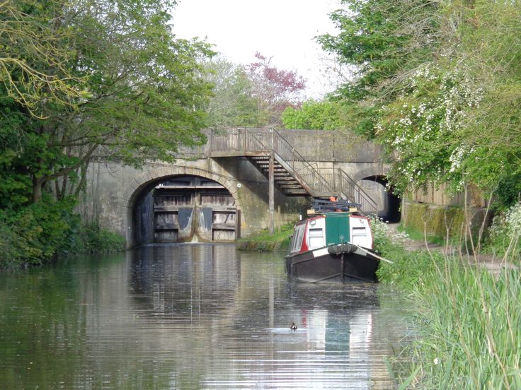 There are many boats along the canal and gorgeous bridges and locks