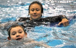Photos by Joseph Robertia, Redoubt Reporter. Special Olympics athlete Bryce Braun is all smiles while taking part in a swimming practice for...
