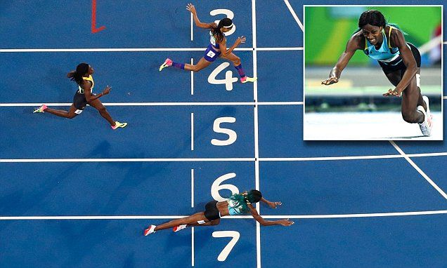 Only BA!!!  Shaunae Miller of the Bahamas DIVES over finish line for gold in 400m