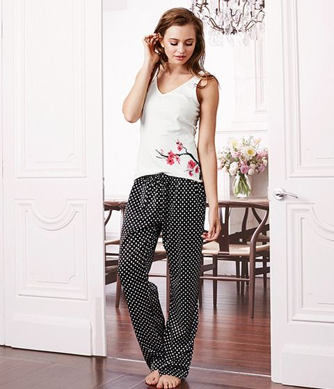 The cherry blossom print is elegantly featured across the top of the garment and catches your eye on a white background. Complimenting this sleek print is a classic and stylish satin black and white polka dot pant. Charice includes a flexible stretch that you will find in both the cotton elastane top and lightweight satin pant allowing you to feel absolute comfort. Charice is the perfect pair to relax and feel elegant in your home.