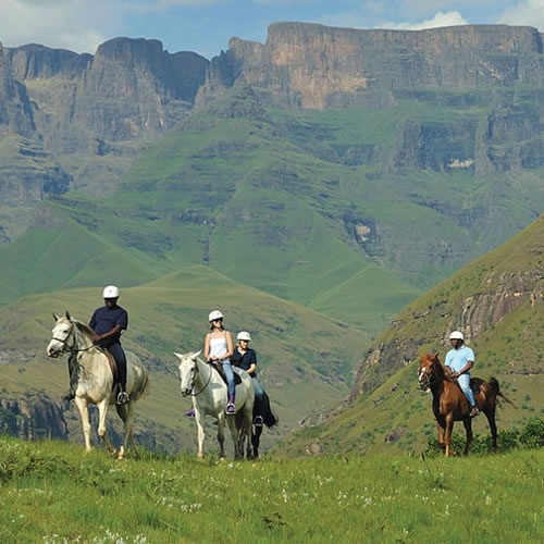 take a guided horse trip into the mountain at Bushman's Nek Berg and Trout Resort, Southern Drakensburg, KZN, South Africa