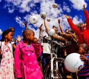 The children of Lentswe Le Moriti village celebrate with their brand new SuperSport Let's Play soccerballs