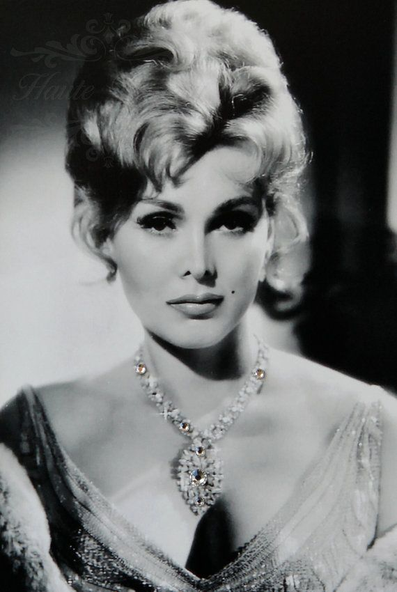 "Sári Gábor (born 6 February 1917), known as Zsa Zsa Gabor, is a Hungarian-born American actress, who acted in supporting roles in movies, on Broadway, and occasionally on television. Gabor was also a socialite. She began her stage career in Vienna, Austria, at the age of 15, and was crowned Miss Hungary in 1936. She emigrated to the United States in 1941 and became a sought-after actress with ""European flair and style"", with a personality that ""exuded charm and grace""."