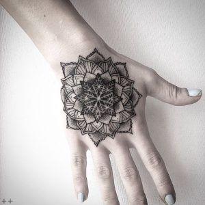Dotwork mandala tattoo on hand by Octavio Camino