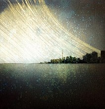 On January 1, 2011, Michael Chrisman set up a pinhole camera, outside, so it pointed at the Toronto skyline. We all know that pinhole cameras typically have a long exposure time, but this was an exposure that lasted 365 days.