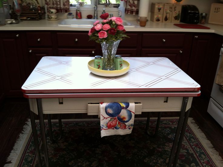 Country inspired vintage kitchen with enamel table from the 40's.