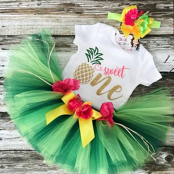 Baby Girl 1st Birthday Outfit Celebrate your little girls first birthday in style with this adorable Pineapple glitter gold tutu outfit! Perfect for a summer luau birthday! You may choose: ~Custom made and personalized Glitter Gold pineapple One bodysuit as shown in picture.