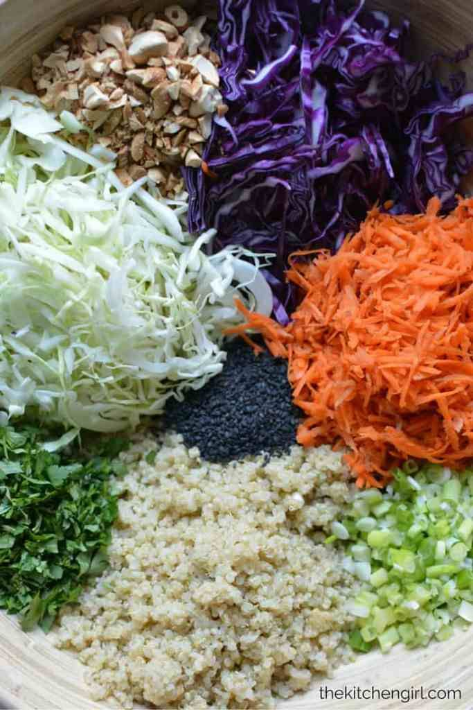 Eat clean with this raw veggie and quinoa salad. Asian Quinoa Slaw Salad Sesame Ginger Vinaigrette. thekitchengirl.com #glutenfree #vegan #dairyfree #asiansalad #choppedsalad #mealprep #healthyrecipe #saladforlunch