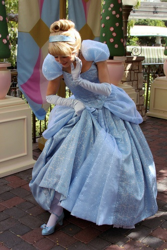 Disneyland Cinderella looking at her slipper. Its still on! - ♡