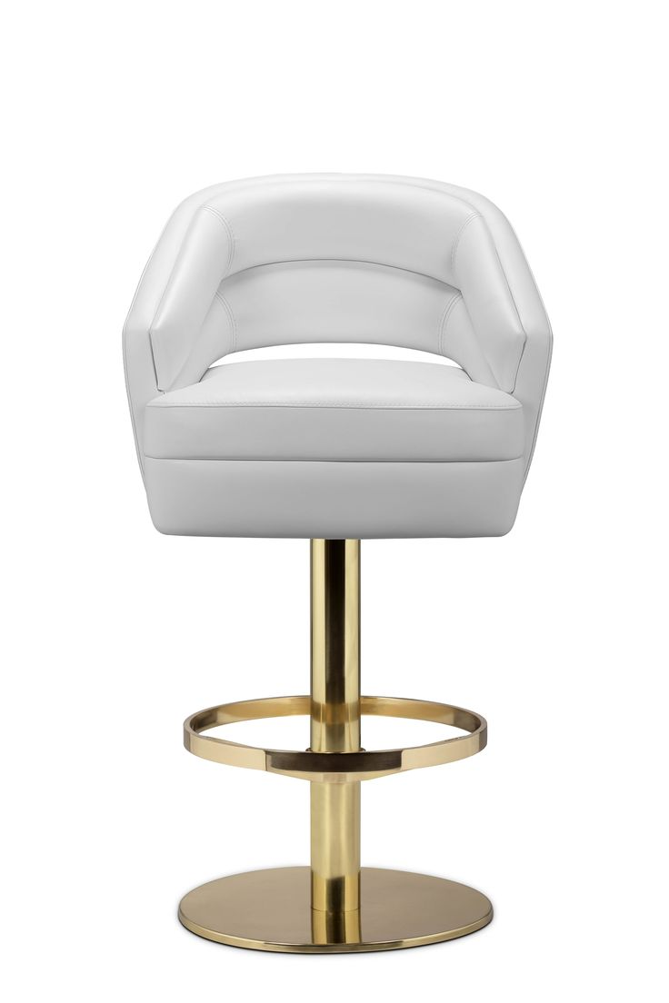 Russel bar chair delve into space age aesthetics, being produced in creamy velvet fabrics mixed with polished brass. The base is round and swivels 360 degrees, providing comfort through the foot rail. Adorn your living room with a sophisticated design piece that incorporates all of the mid-century elements.