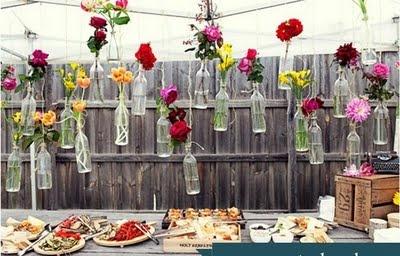 wine bottles turned flower vases floating above the dining table