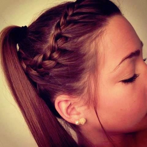Braided ponytail. I do this all the time, but I make it a bun for dance.