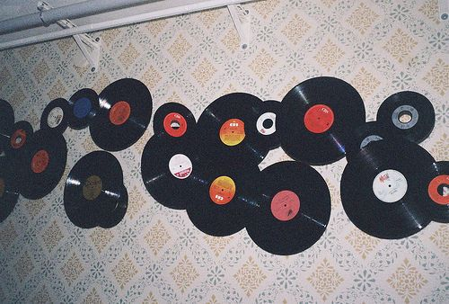 Very hipster bedroom walls! Such a great use of old vinyl.