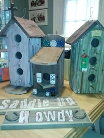 Birdhouses made of old fencing...and a couple of signs as well