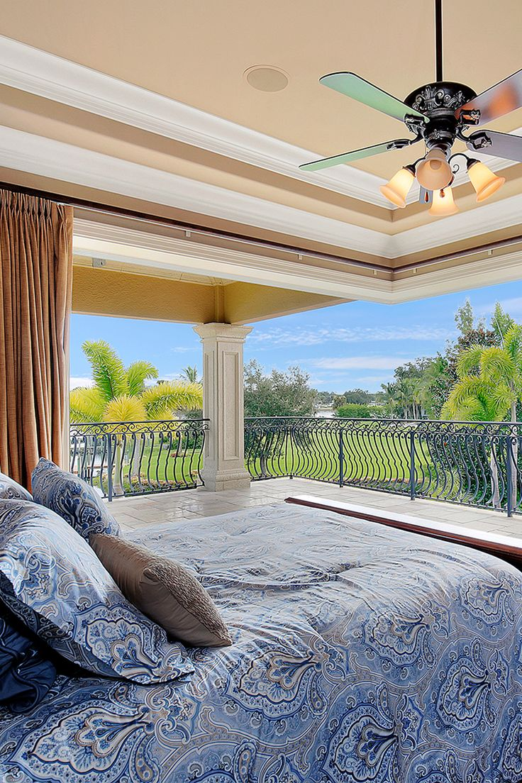 Mediterranean inspired bedroom with breathtaking views. Balanced in natural colours this is a true masterpiece with custom details throughout include, crown molding, coffered ceilings, wrought iron detailing and travertine flooring. | homeadverts.com