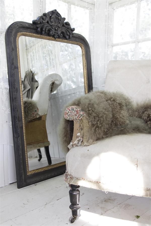 Old carved mirror, detail of the vintage chair, whites, softness of the woolen throw.