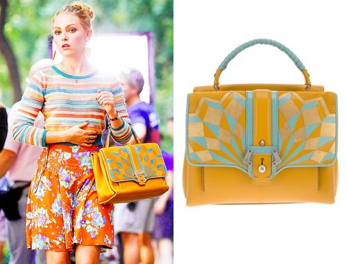 AnnaSophia Robb was seen carrying this yellow and turquiose bag with a geometric inlaid pattern while filming season 2 of The Carrie Diaries...
