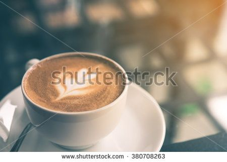 Cup of Latte in coffee shop background  - stock photo