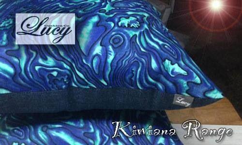 Kiwiana style cushion with paua she'll design fabric by lucy