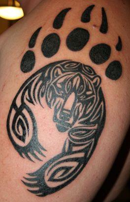 bear print tattoo designs | Tribal Bear And Claw Tattoos || Tattoo from Itattooz