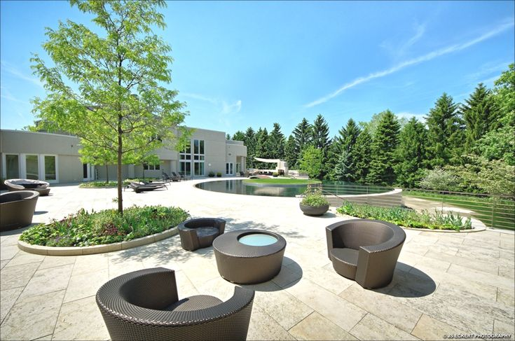 golden outdoor furniture beside circle pond: the majestic residence of the brilliant michael jordan